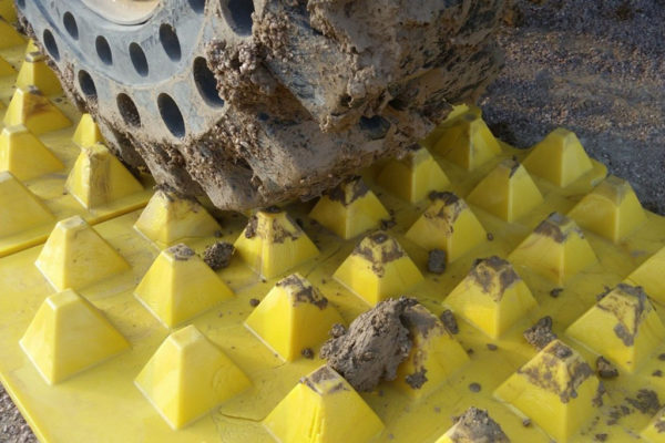Close up of tyres being cleaned of mud