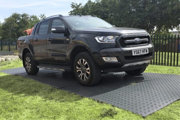 Temporary ground grass turf protection for builders truck