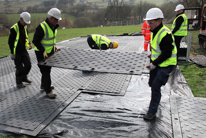 Ground protection mats easy to lift by hand