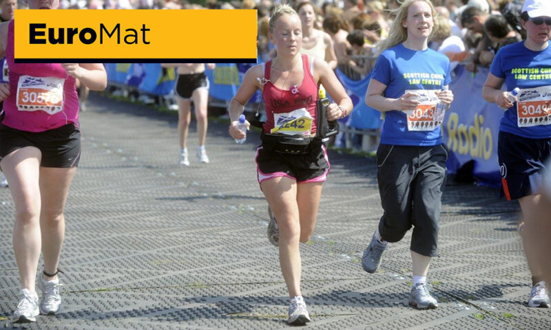 runners on a temporary road racetrack at sporting event race