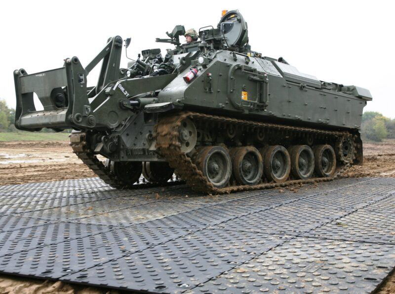 tank driving across a temporary portable roadway