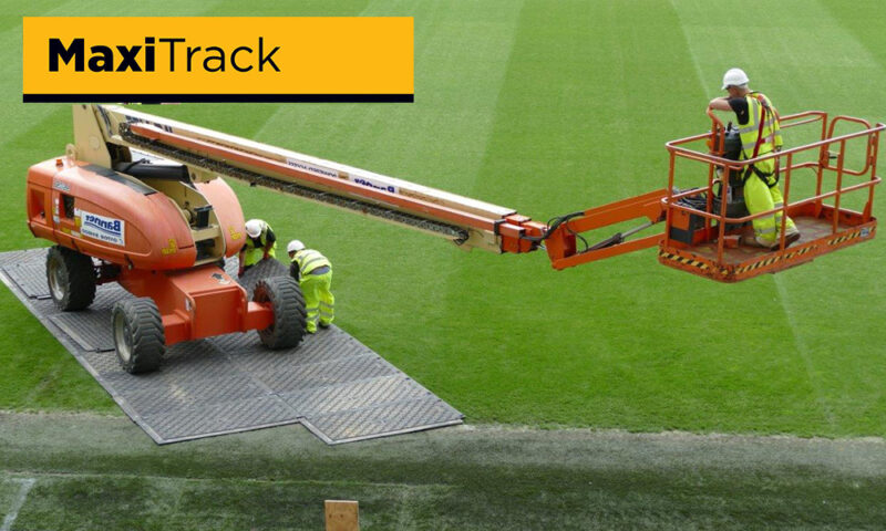 Temporary ground grass turf protection for cherry picker in sports stadium